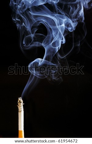 Smoking cigarette. Isolated on black.
