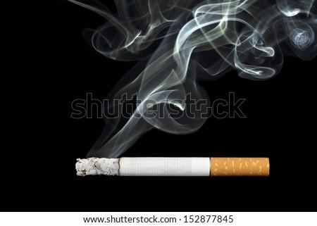 smoking cigarette on black...