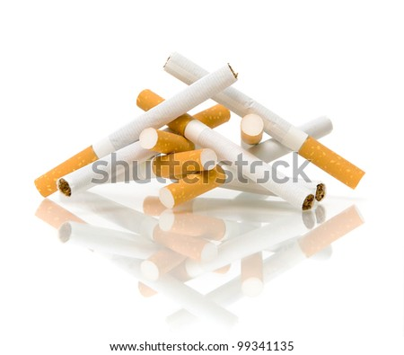 Smoking cigarettes isolated on the white background close-up of the reflection