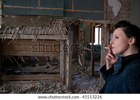 smoking girl at ruined house
