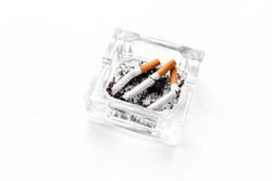 Smoking. Half-smoked cigarettes in ashtray on white background copyspace