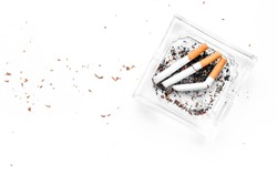 Smoking. Half-smoked cigarettes in ashtray on white background top view copy space
