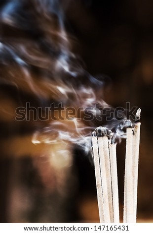 Smoking incense sticks in chinese temple