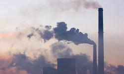 Smoking industrial chimneys at dawn. Concept for environmental protection