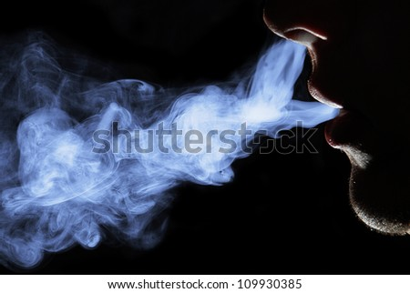 Smoking man. Black background