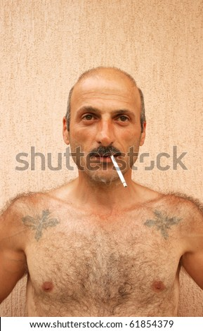Smoking man vertical picture. - stock photo