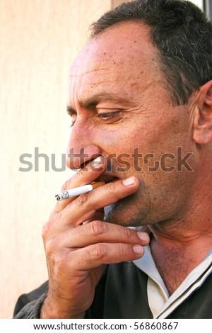 Smoking man vertical portrait.