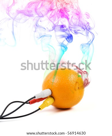 Smoking orange in which three cables are thrust.