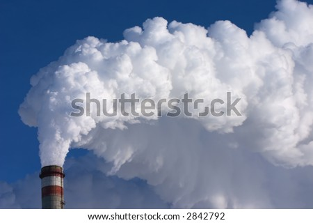smoking pipes of factory, contaminating an environment on a background clean sky