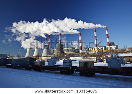 Smoking pipes of power plant against the blue sky