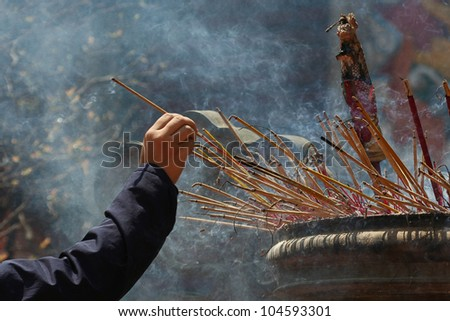 Smoking prayer sticks at vietnamese pagoda