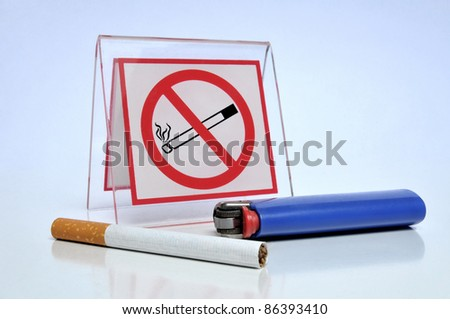 Smoking prohibited - Blue lighter, cigarette and no smoking sign on blue glossy background