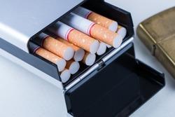 Smoking set. Pocket lighter, cigarette and pack of cigarettes