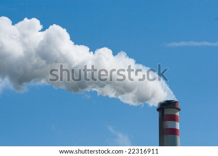 smoking smokestack with blue sky