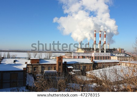 Smoking stacks of the thermal power station against a blue sky