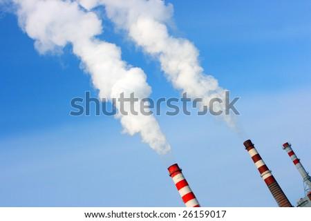 Smoking stacks of thermal power station - stock photo