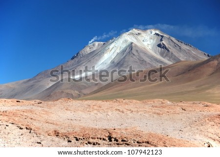 smoking volcano in the bolivian desert