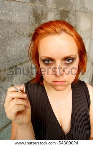 Smoking young woman close up
