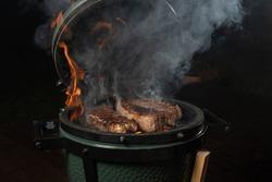 Smoky new york steak on egg type grill.
