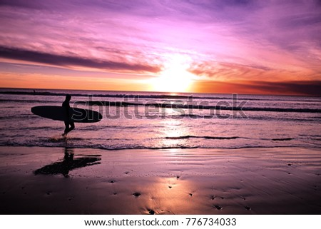 Stock Photo Smoky sunset surfer silhouette