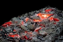 Smoldering ashes of a bonfire