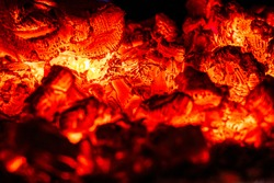 Smoldering coal, glowing embers in the fireplace