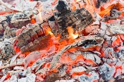 Smoldering lump charcoal of the quebracho tree, smoldering Ash