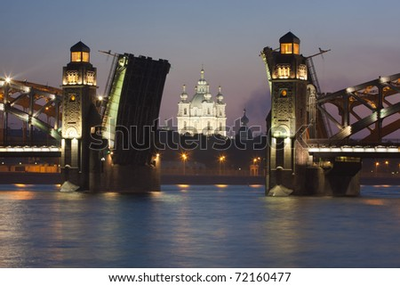 Smolny cathedral through open drawbridge. Bolsheohtinskiy bridge, St.Petersburg, Russia.