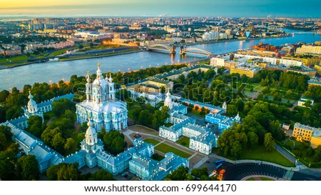 Smolny Cathedral with a view of Bolsheokhtinsky bridge. St. Petersburg view of the Neva River. #699644170
