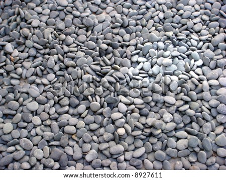 Smooth beach stones in piles