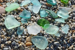 Smooth colored glass treated by water of Lake Baikal for long time