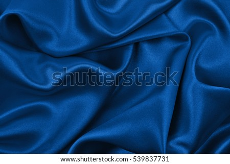 smooth elegant blue silk or satin luxury cloth texture can use as abstract background luxurious