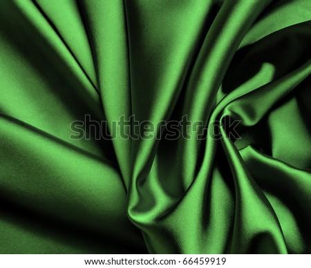 Smooth elegant green satin background. - stock photo