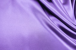 Smooth elegant purple violet color silk or satin luxury cloth fabric texture, abstract background design.