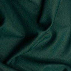 Smooth fabric texture with folds and wawes. Close up silk background