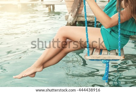 Smooth female legs above water