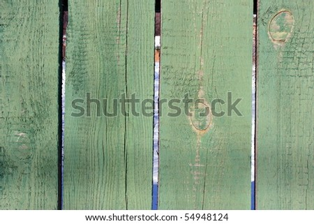 Smooth fence pine boards painted green