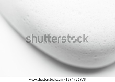 Smooth foam soap form abstract background with selective focus. Close up, macro #1394726978