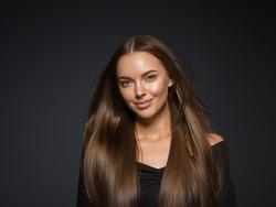 Smooth hair beauty woman longhair brunette female model natural make up beautiful girl over dark background