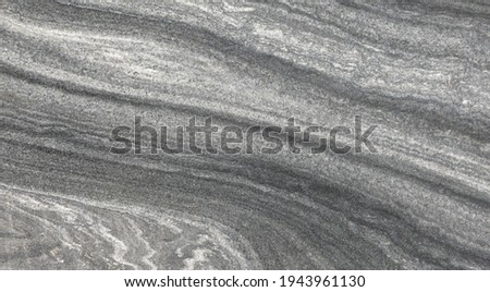 Smooth honed, gray stone slab with an abstract pattern in close-up Stockfoto ©
