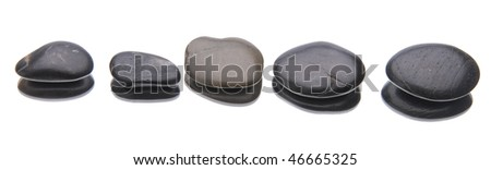 Smooth river rocks with a reflection isolated on white.