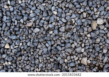Smooth round pebbles texture background. Pebble sea beach close-up, dark wet pebble and gray dry pebble. High quality photo Imagine de stoc ©