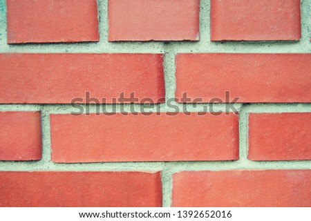 smooth wall of smooth red brickwork