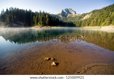 smooth water of mountain lakes