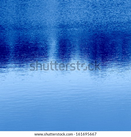 smooth water surface with reflection