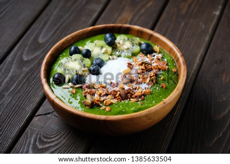 Smoothie bowls. Healthy breakfast bowl with chia seeds, muesli, berries, fruits and coconut flakes coconut flakes. Vegan food. #1385633504
