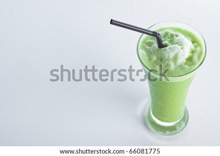 smoothie Green tea with a straw isolated on white background.