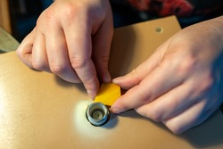 smoothing edges of the stained glass pieces with a glass grinder