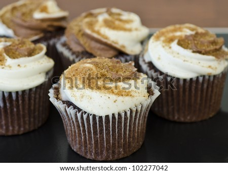 smores cupcakes on dark background
