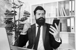 SMS alert for business marketing. Bearded man read SMS in smartphone. SMS message. SMS service. Text messaging. Business texting. Mobile lifestyle. Modern life. Business communication